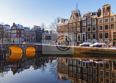 Beautiful early morning winter view on one of the Unesco world heritage city canals of Amsterdam, The Netherlands.