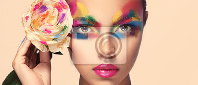 Poster Beautiful girl model with multi-colored paints on her face. Woman with rose flower and bright color make-up. Cosmetics, beauty and makeup.  Spring and summer flowering  shopping