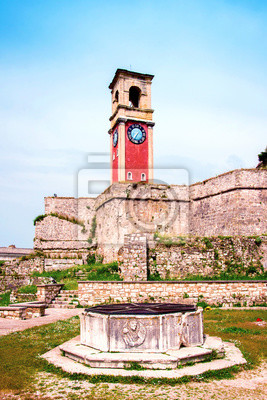 Beautiful landscape with a clock and bell tower in the old fortress in Kerkira, Corfu, Greece. popular tourist attractions. amazing places.