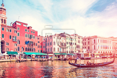 Beautiful landscape with gondola on the canal in Venice, Italy. Landmarks. The city of pilgrimage.