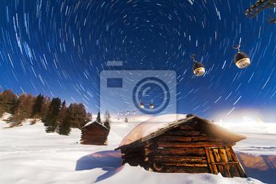 Beautiful long exposure star trail looking towards Polaris in the Italian alps