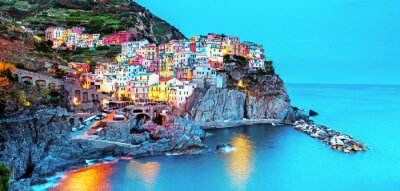 Beautiful magic colorful summer landscape on the coast of Manarola in Cinque Terre, Liguria, Italy at night.  Exotic amazing places. Popular tourist atraction.