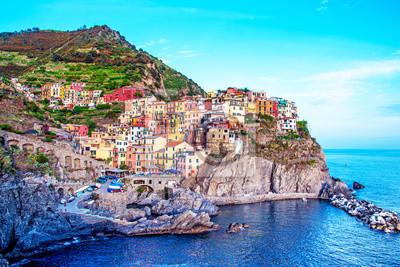 Beautiful magic colorful summer landscape on the coast of Manarola in Cinque Terre, Liguria, Italy.  Exotic amazing places. Popular tourist atraction.