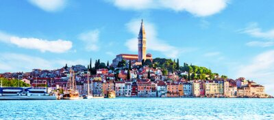 Beautiful  magical city landscape with sea, colorful houses and an ancient tower in Rovinj, Croatia. popular tourist attraction. (vacation, rest - concept)