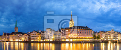 Beautiful panorama of the city of Zurich, Switzerland, at the river Limmat in the blue hour with the Fraumünster and St. Peter churches on the skyline