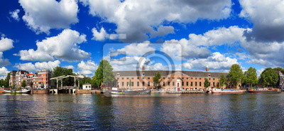 Beautiful panoramic panorama of museum the Hermitage at the river Amstel in Amsterdam, the Netherlands, on a sunny summer day with clouds