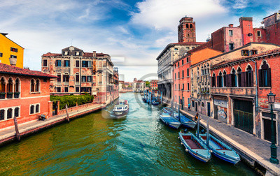 Beautiful spring view of Vennice with famous water canal and colorful houses. Splendid morning scene in Italy, Europe. Magnificent Mediterranean cityscape. Traveling concept background.