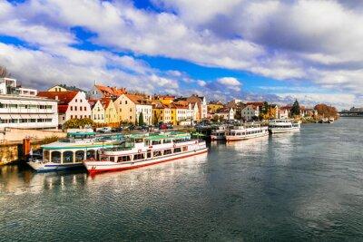 Beautiful towns of Germany - scenic Regensburg over Danube river famous for cruises. Landmarks of Bavaria