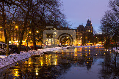 Beautiful twilight view in winter on the Stadhouderskade with the national state museum in the background in Amsterdam, the Netherlands