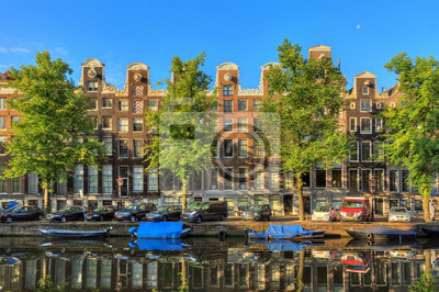 Beautiful view of the iconic canal houses at the UNESCO world heritage Keizersgracht canal  in Amsterdam, the Netherlands, on a sunny summer day with a blue sky