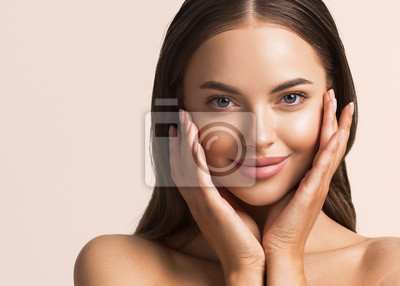 Poster Beautiful woman face close up natural make up hand touching face beauty smile