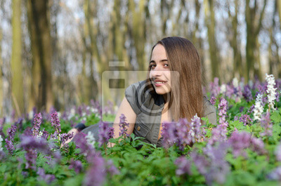 Beautiful young sexy girl on a sunny day in spring forest among