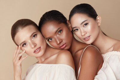 Poster Beauty. Group Of Diversity Models Portrait. Multi-Ethnic Women With Different Skin Types Posing On Beige Background. Tender Multicultural Girls Standing Together And Looking At Camera.