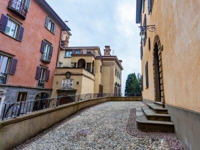 Bergamo, Italy, February 16, 2020. Picturesque narrow street in the Upper Town (Citta Alta).