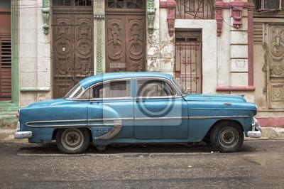 Blue car in Havana on a rainy day