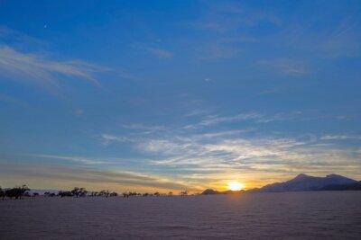 Blue sky at sunrise in the desert