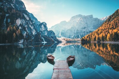 Poster Boats on the Braies Lake ( Pragser Wildsee ) in Dolomites mountains, Sudtirol, Italy