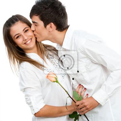 Boy geben Mädchen eine Rose und romantischen Kuss.