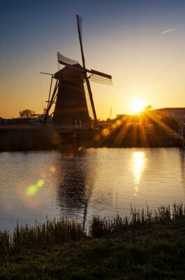 breathtaking beautiful inspirational landscape with windmills in Kinderdijk, Netherlands at sunrise. Fascinating places, tourist attraction.