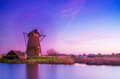 breathtaking beautiful inspirational landscape with windmills in Kinderdijk, Netherlands at sunset.