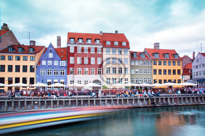 Breathtaking beautiful scenery with  in the famous Nyhavn with strips from the trail of the sailing boat in Copenhagen, Denmark. Exotic amazing places. Popular tourist atraction.