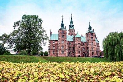 Breathtaking magical autumn  landscape with famous Rosenborg Castle in Copenhagen, Denmark. Exotic amazing places. Popular tourist atraction.