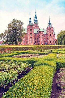Breathtaking magical landscape with park patterns in famous Rosenborg Castle in Copenhagen, Denmark. Exotic amazing places. Popular tourist atraction.