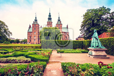 Breathtaking magical landscape with statue of Queen Caroline Amalie in the park of famous Rosenborg Castle in Copenhagen, Denmark. Exotic amazing places. Popular tourist atraction.