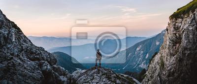 Poster Breathtaking Views From Mangart Peak at Stunning Sunrise. Peaks Above Clouds.