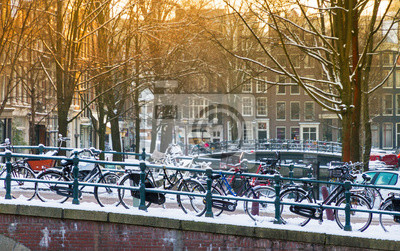 Bridge with bicycles in Amsterdam, the Netherlands, early in the morning in winter