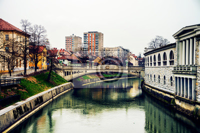 Bridge with famous old buildings in the city center