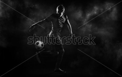 Poster bright soccer playerl on the black background