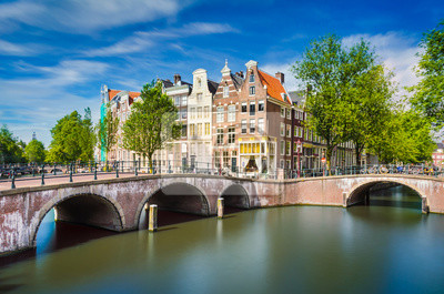 Poster Canal with traditional buildings in Amsterdam, Netherlands
