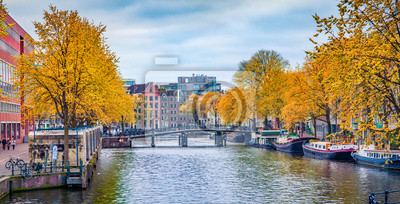 Captivating autumn scene of Amsterdam city. Famous Dutch channels and great cityscape. Panoramic morning view of Netherlands, Europe. Traveling concept background.