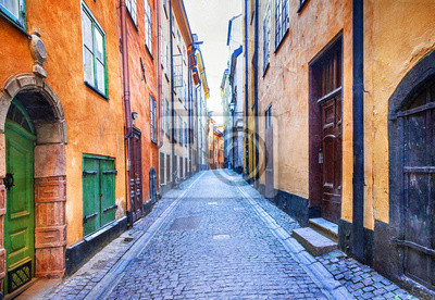 Charming colorfu narrow streets of old town in Stockholm, Sweeden