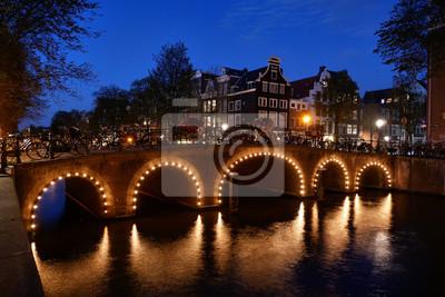 Charming evening lights on an Amsterdam canal bridge