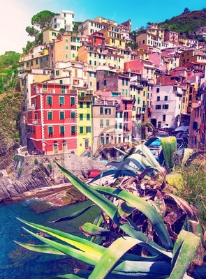 charming fascinating city landscape with rocks on the coast of Riomaggiore in Cinque Terre, Liguria, Italy. beautiful places.