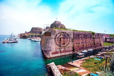 charming landscape with the old fortress and canal with boats in Kerkira (Kepcipa), Corfu, Greece. tourist attractions. amazing places.