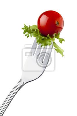 Cherry-Tomaten und Endivien auf einer Gabel