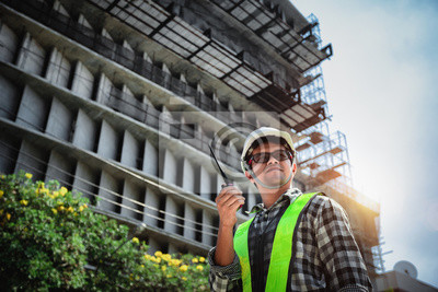 Poster Civil Engineers people in construction site or building site of highrise building