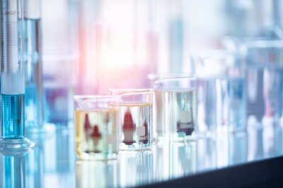Poster Close-up Of Liquid In Beakers On Table At Laboratory