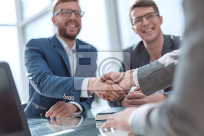 Poster close up. successful business people shaking hands
