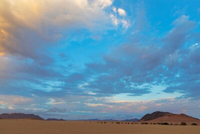Clouds colored at sunrise in the Namib Desert