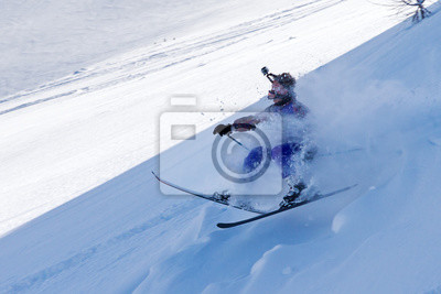 Clumsy skier crashes hard in the powder in the backcountry