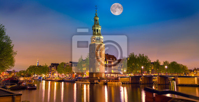 Colorful night scene with Montelbaanstoren tower