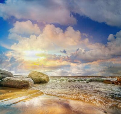 Poster Colorful panoramic landscape with stones and waves at the lake shore on sunset. Lithuania. Kauno marios.