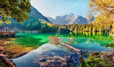Poster Colorful summer view of Fusine lake. Bright morning scene of Julian Alps with Mangart peak on background, Province of Udine, Italy, Europe. Traveling concept background.