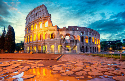 Poster Colosseum morning in Rome, Italy. Colosseum is one of the main attractions of Rome. Coliseum is reflected in puddle. Rome architecture and landmark.