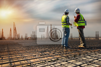 Poster Construction engineers discussion with architects at construction site or building site. Consultant in construction site jobs concept.