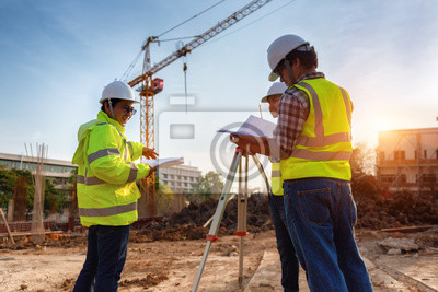 Poster Construction engineers discussion with architects at construction site or building site of highrise building with Surveying for making contour plans is a graphical representation of the lay in land.